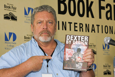 Jeff Lindsay with his book, Dexter by Design; Image: Property of Palley Promotes, Miami Book Fair International 2009 (used by permission)